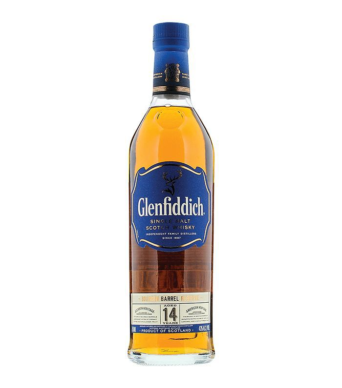 A bottle of Glenfiddich 14-Year Bourbon Barrel Reserve with a blue label and top.