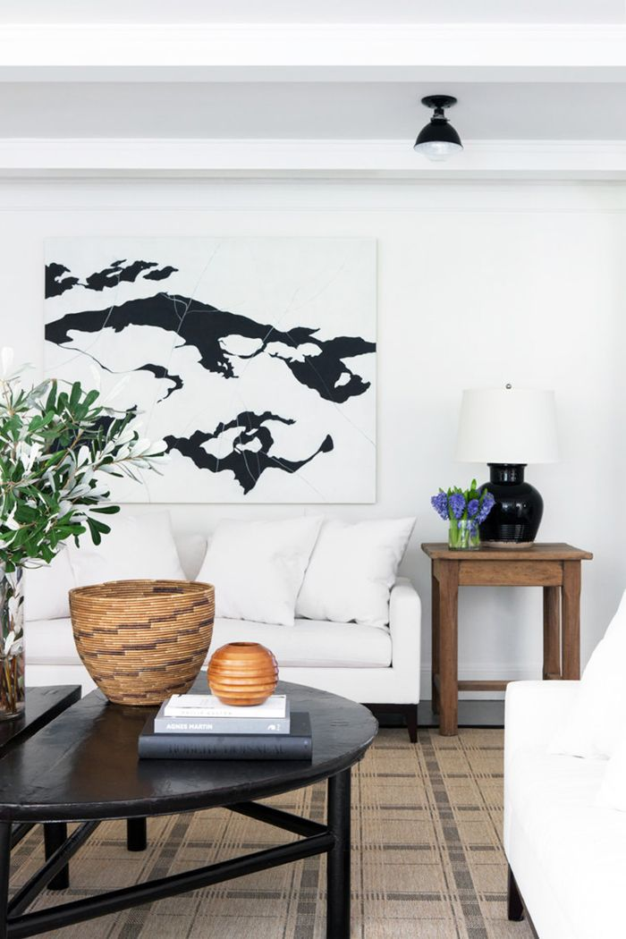 sitting room with large artwork above the couch