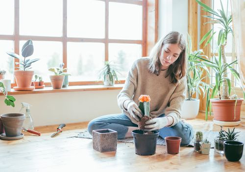 woman potting plants