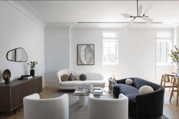 Modern industrial apartment living room with rounded sofas.