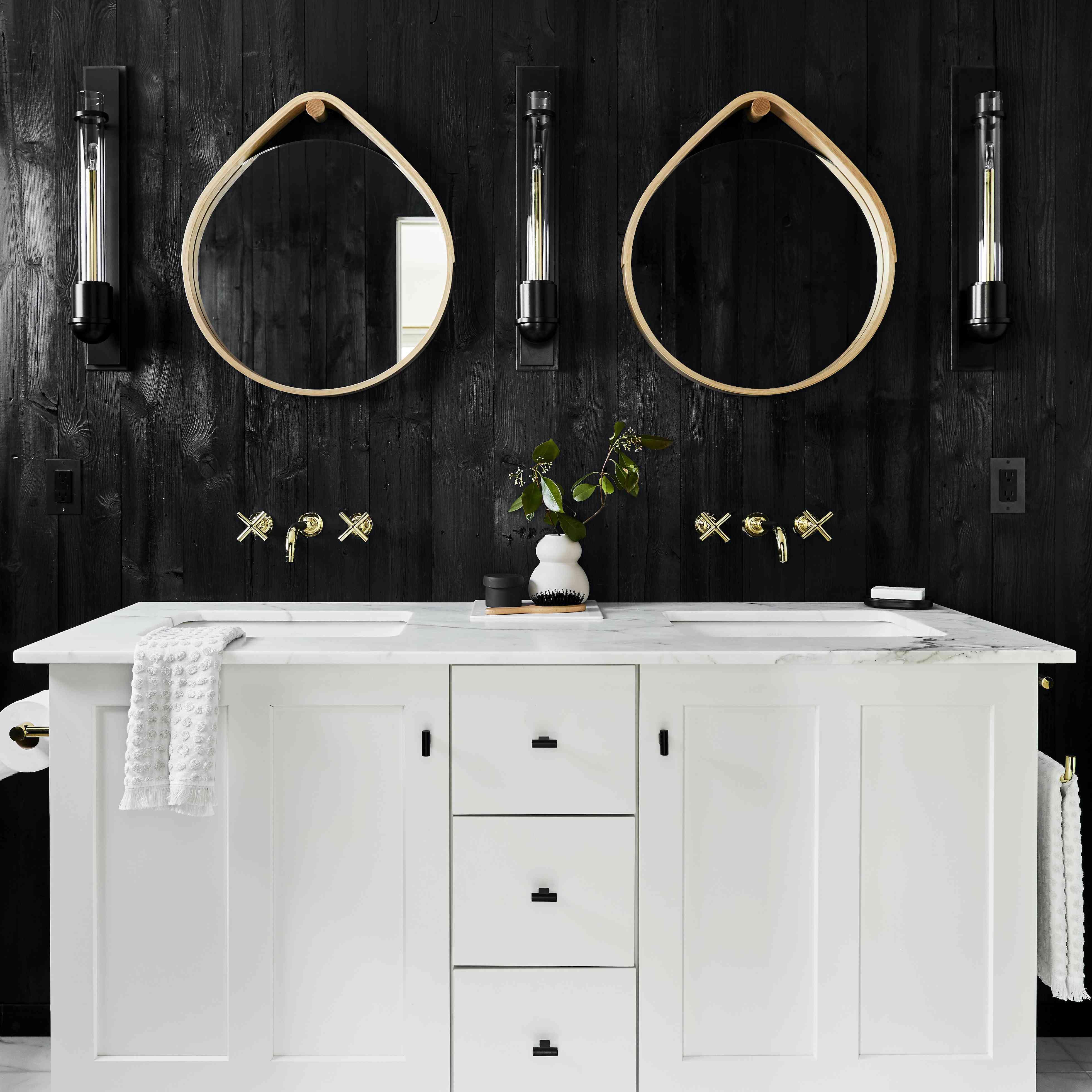 Bathroom with black washed wood walls