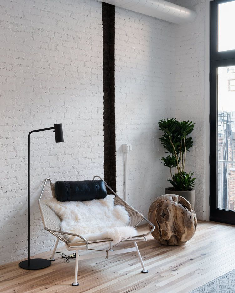 White lounge chair in loft.