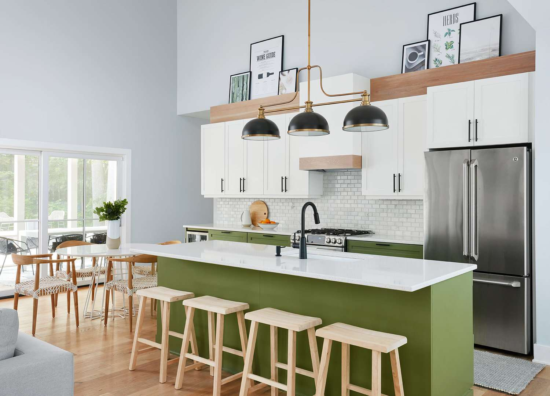 gray kitchen rug in a green kitchen