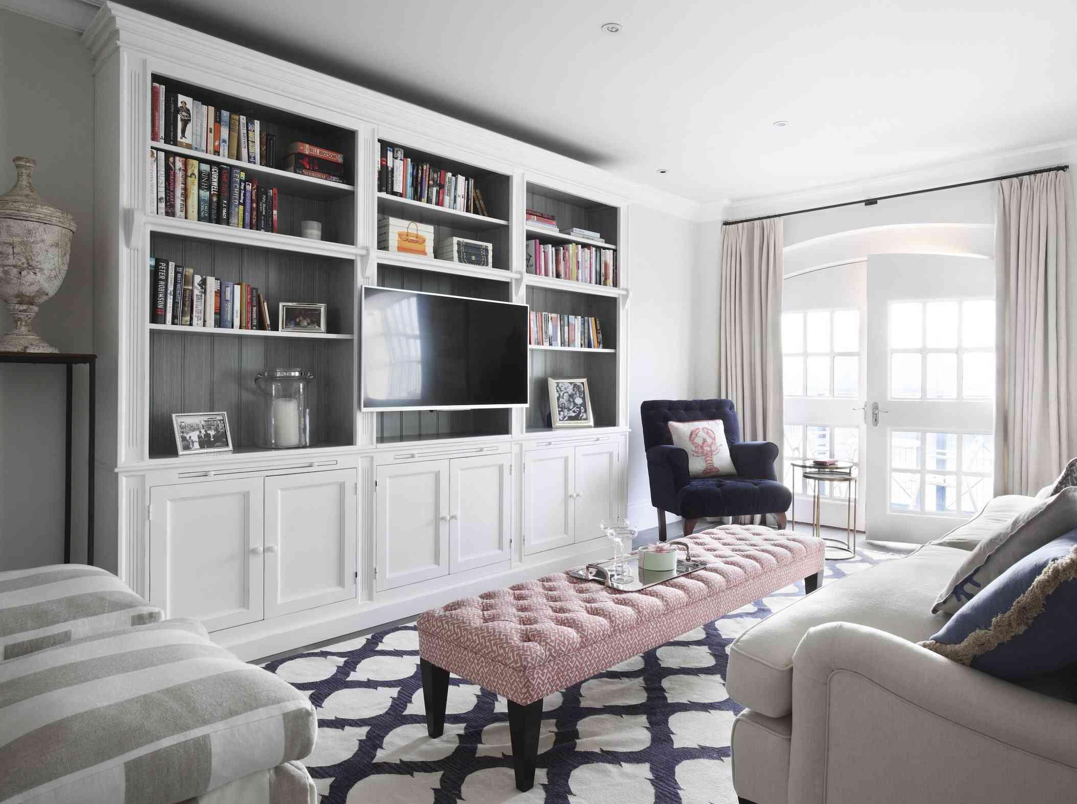 framed tv with bookshelves