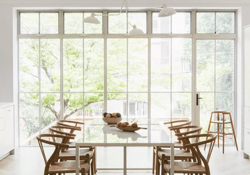 All-white kitchen with dining table
