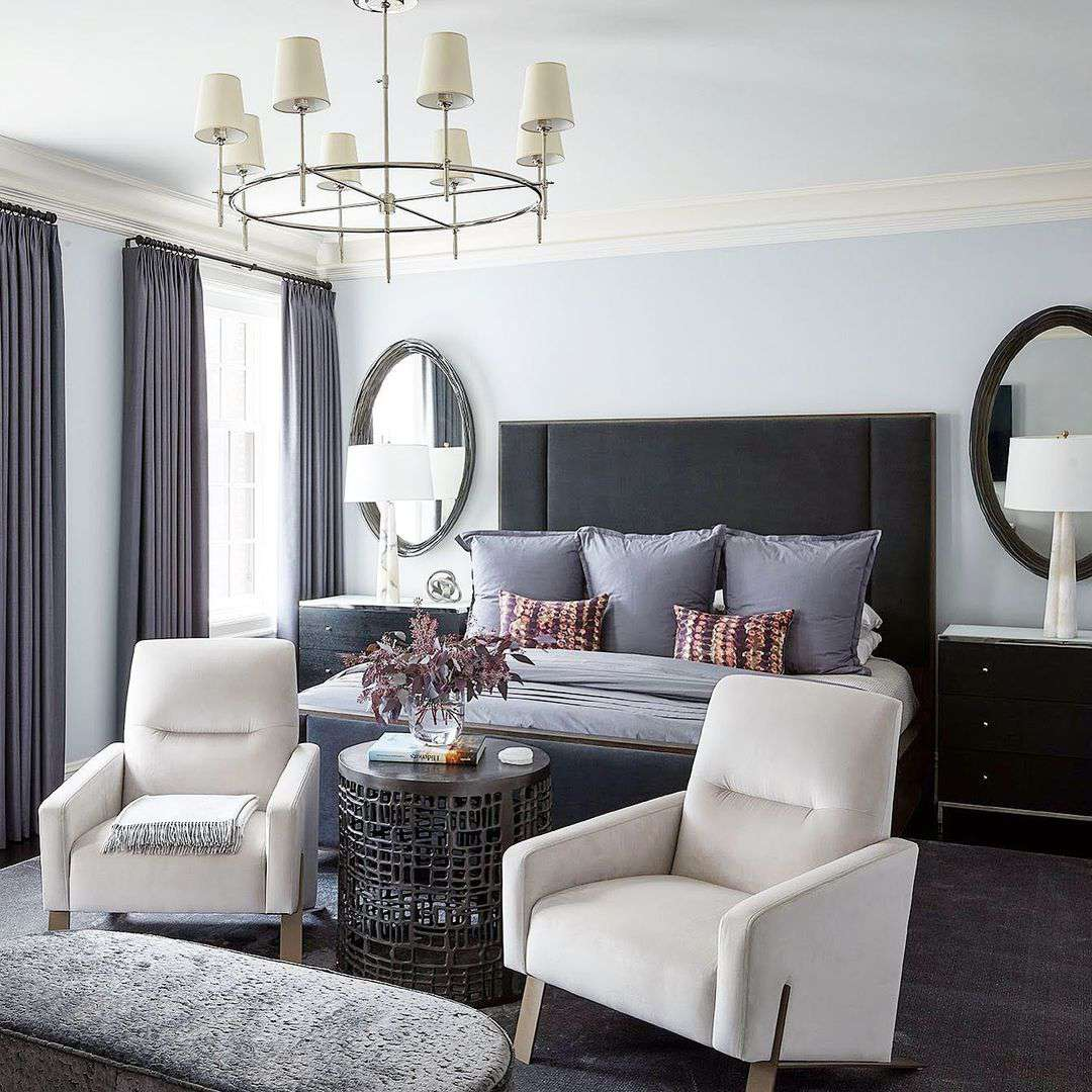 Bedroom with two accent chairs