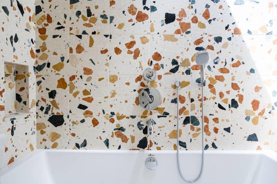 Terrazzo tiled shower stall.