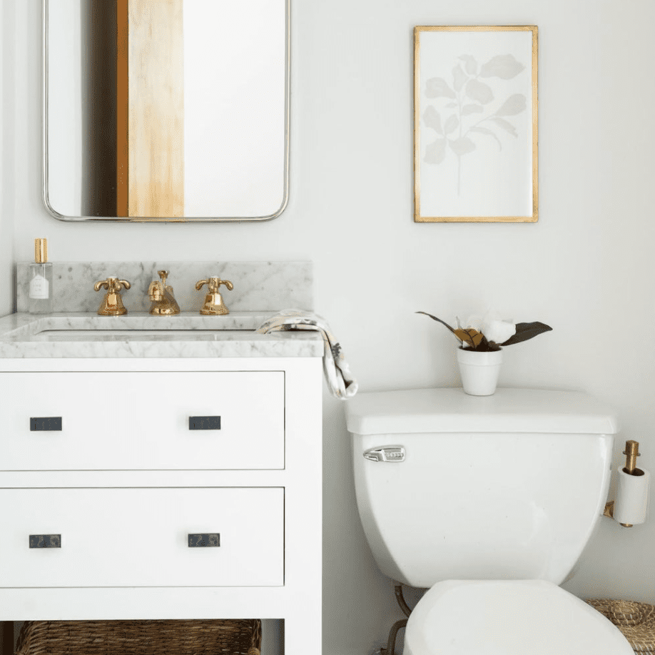 Small bathroom with cute flower and art.