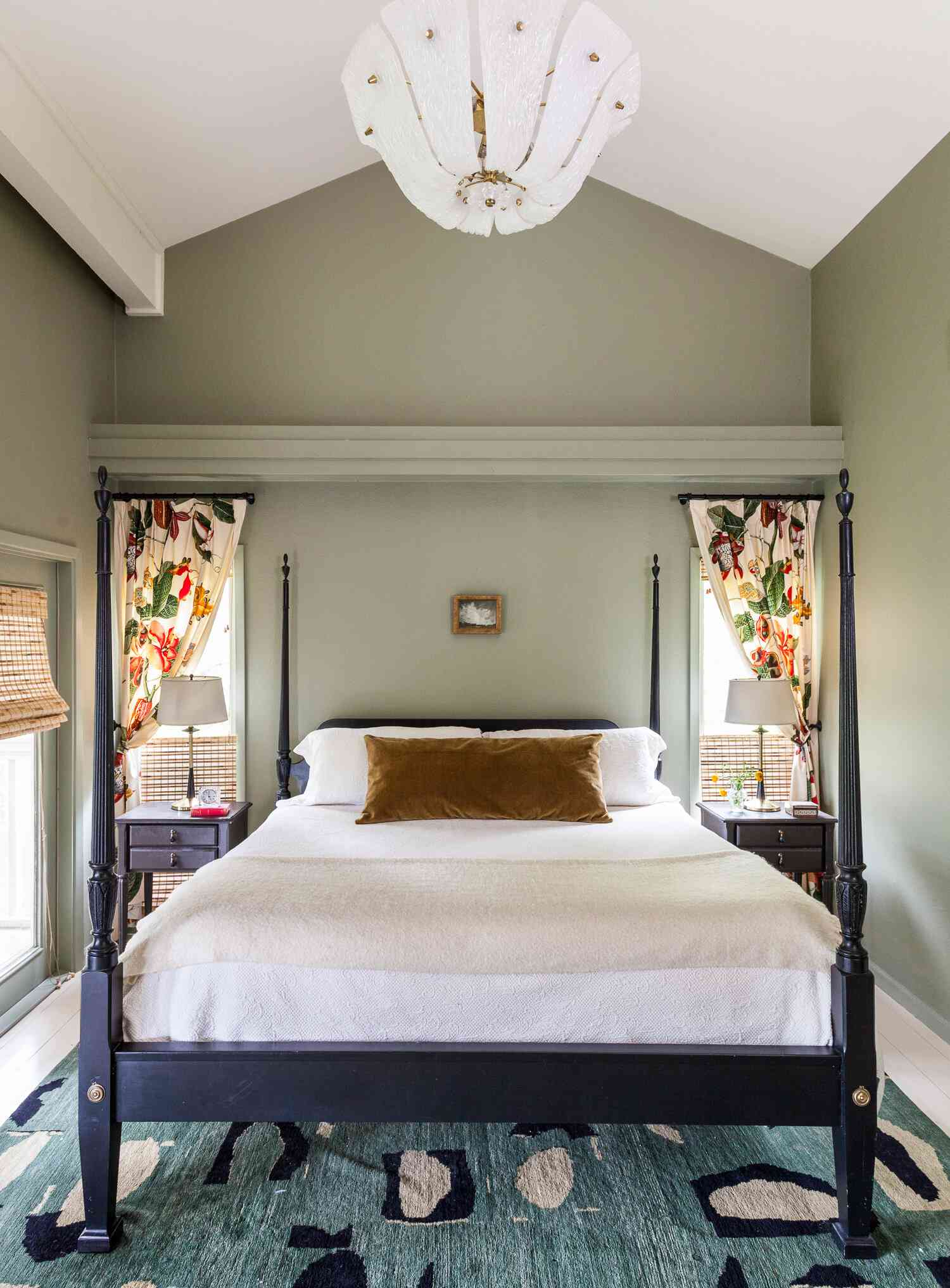 A bedroom with bold floral curtains