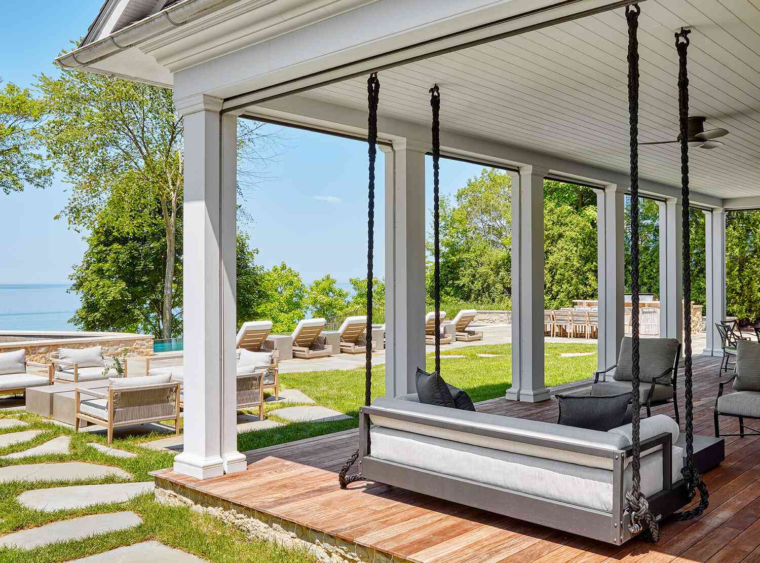 outdoor patio with hanging sofa swing