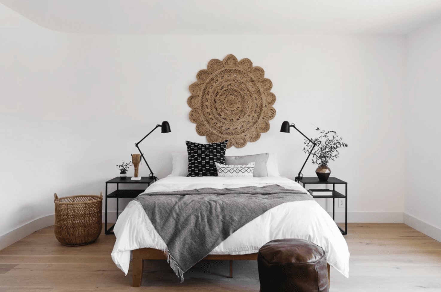 A bedroom with two nightstands and a woven basket