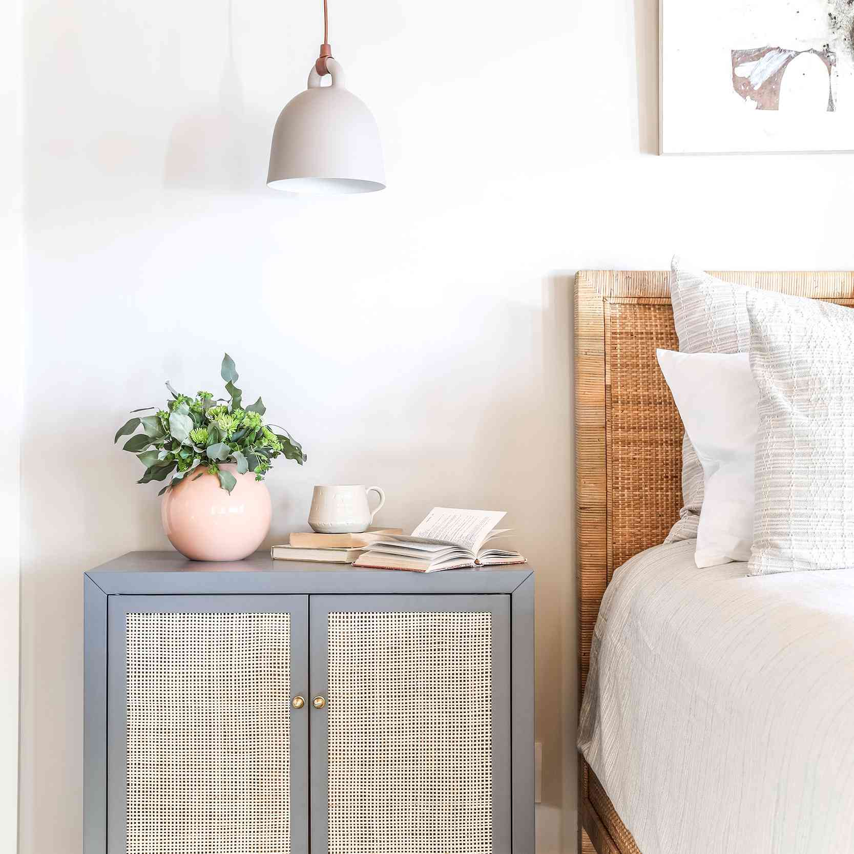 Bright bedroom with light gray walls and woven elements