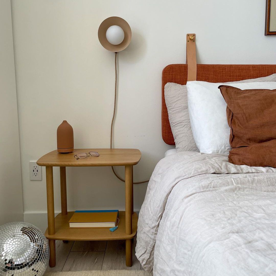 Bedroom with sconce and nightstand