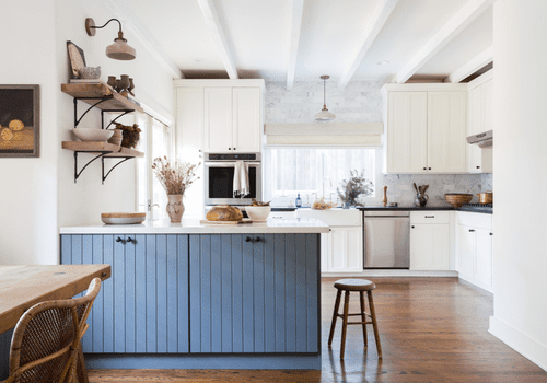 Kitchen with a bit of a vintage feel and blue painted island.