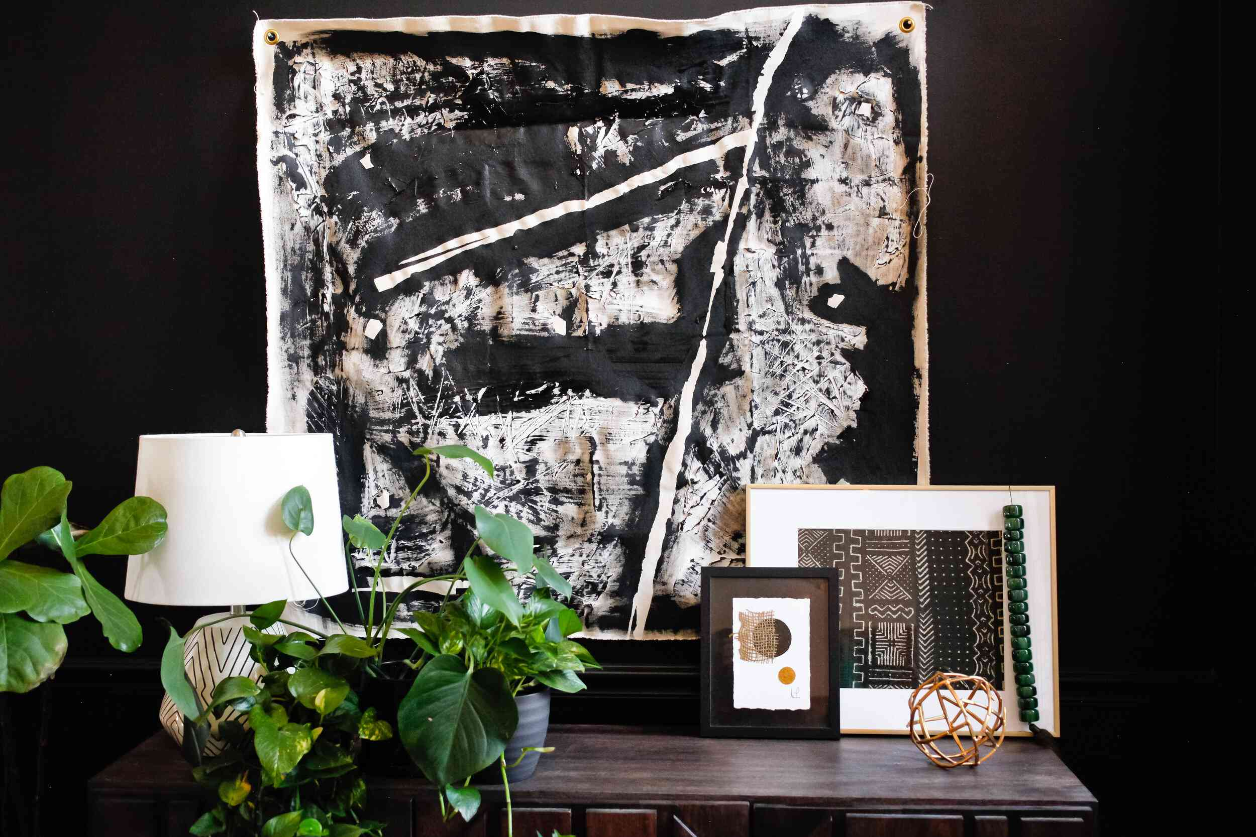 Black and white art display with black wall