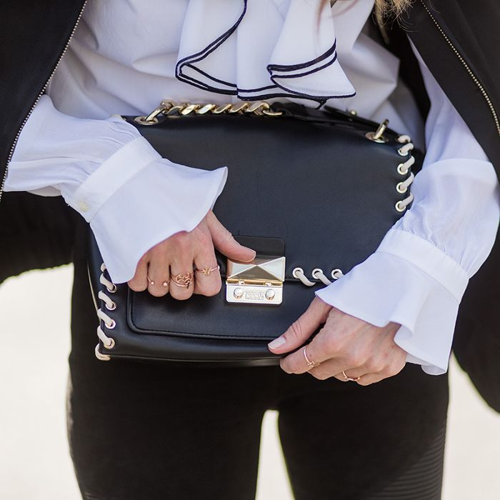 a woman holding her purse