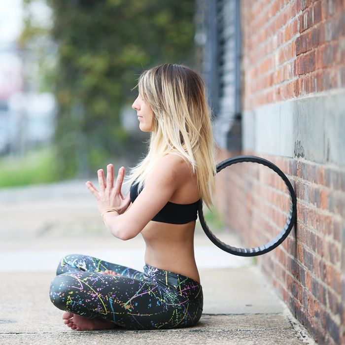 Yoga wheel: woman with yoga wheel