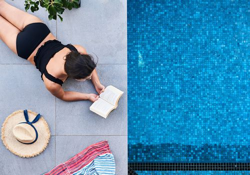 reading by pool