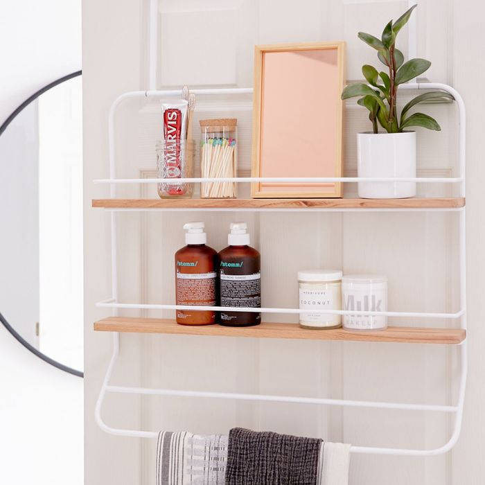 Hanging shelf with various bath items