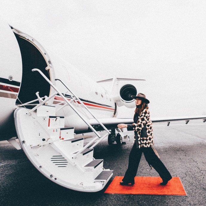 a woman walking on to a plane