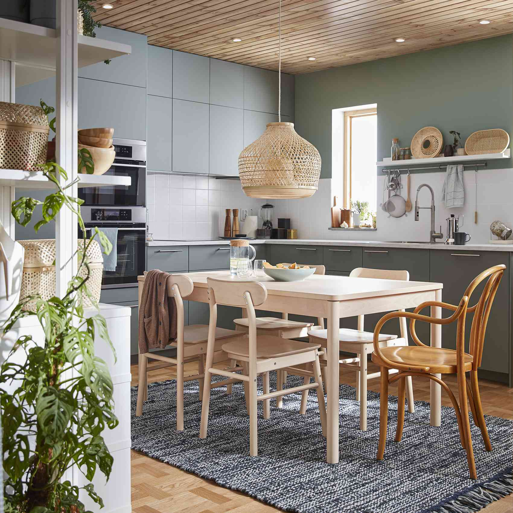 kitchen with green cabinets and rattan lighting