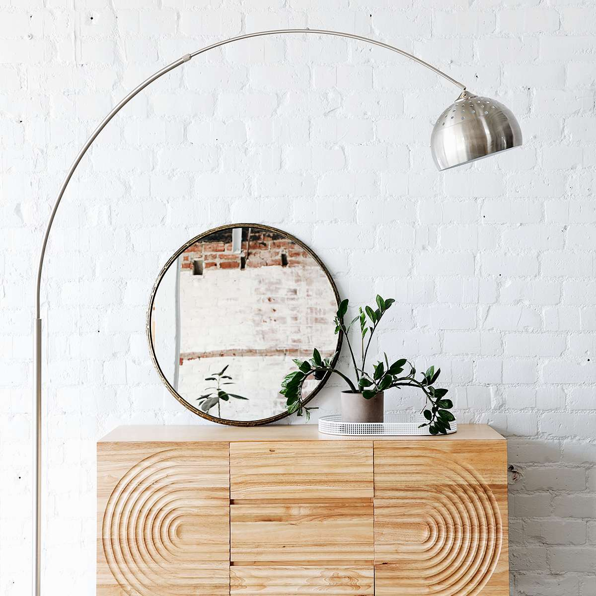 Credenza setup with mirror, arc lamp, and zz plant