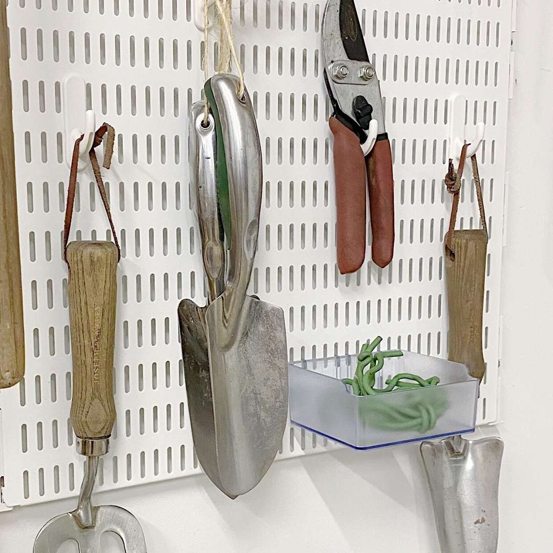 Pegboard with gardening tools