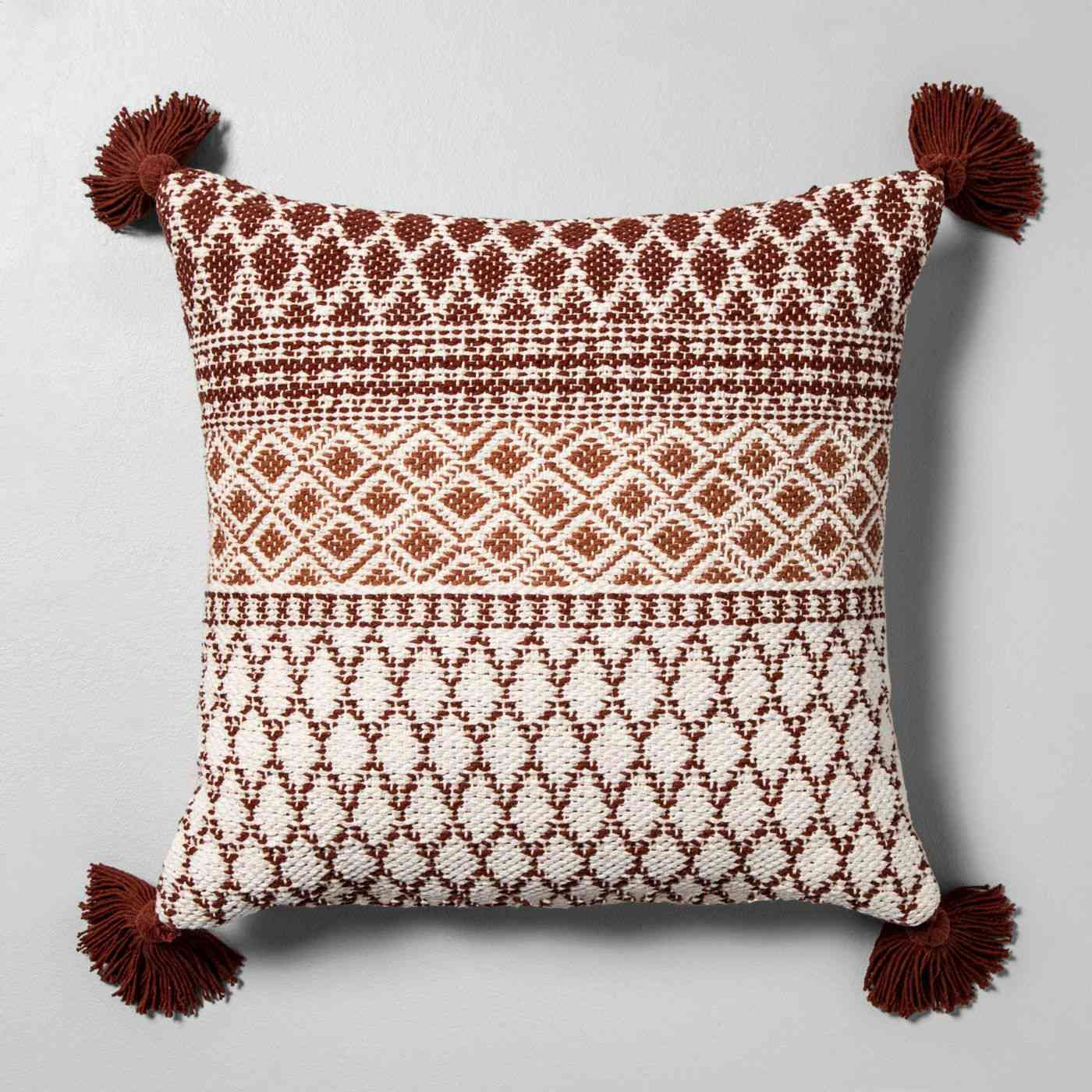 patterned throw pillow with tassels