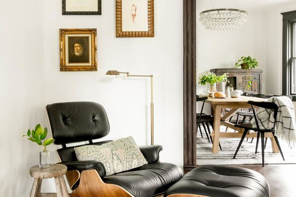 corner with Eames chair and art on the wall