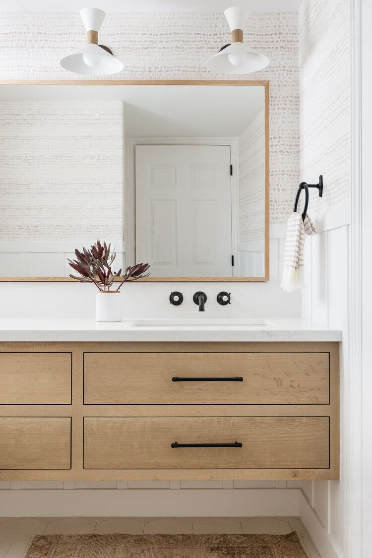 A wall-mounted bathroom vanity that hovers about 1 foot above the floor