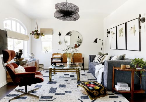 A midcentury-modern style living room with an eclectic mix of furniture, pattern, and color.