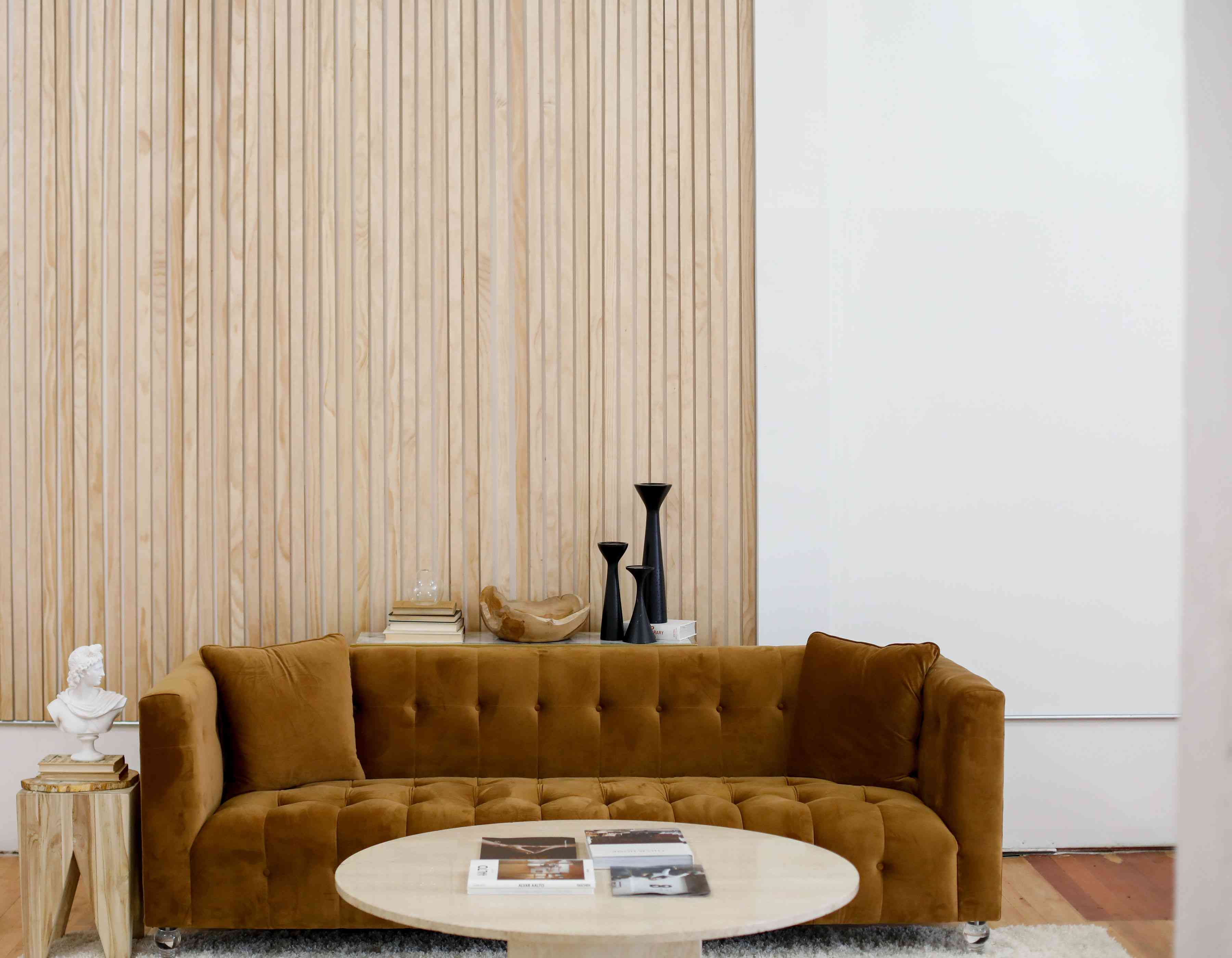 wood paneled wall with brown couch