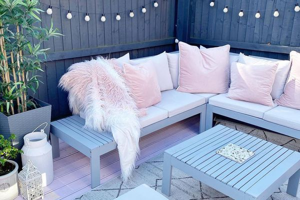 Pink outdoor cushions on outdoor couch.