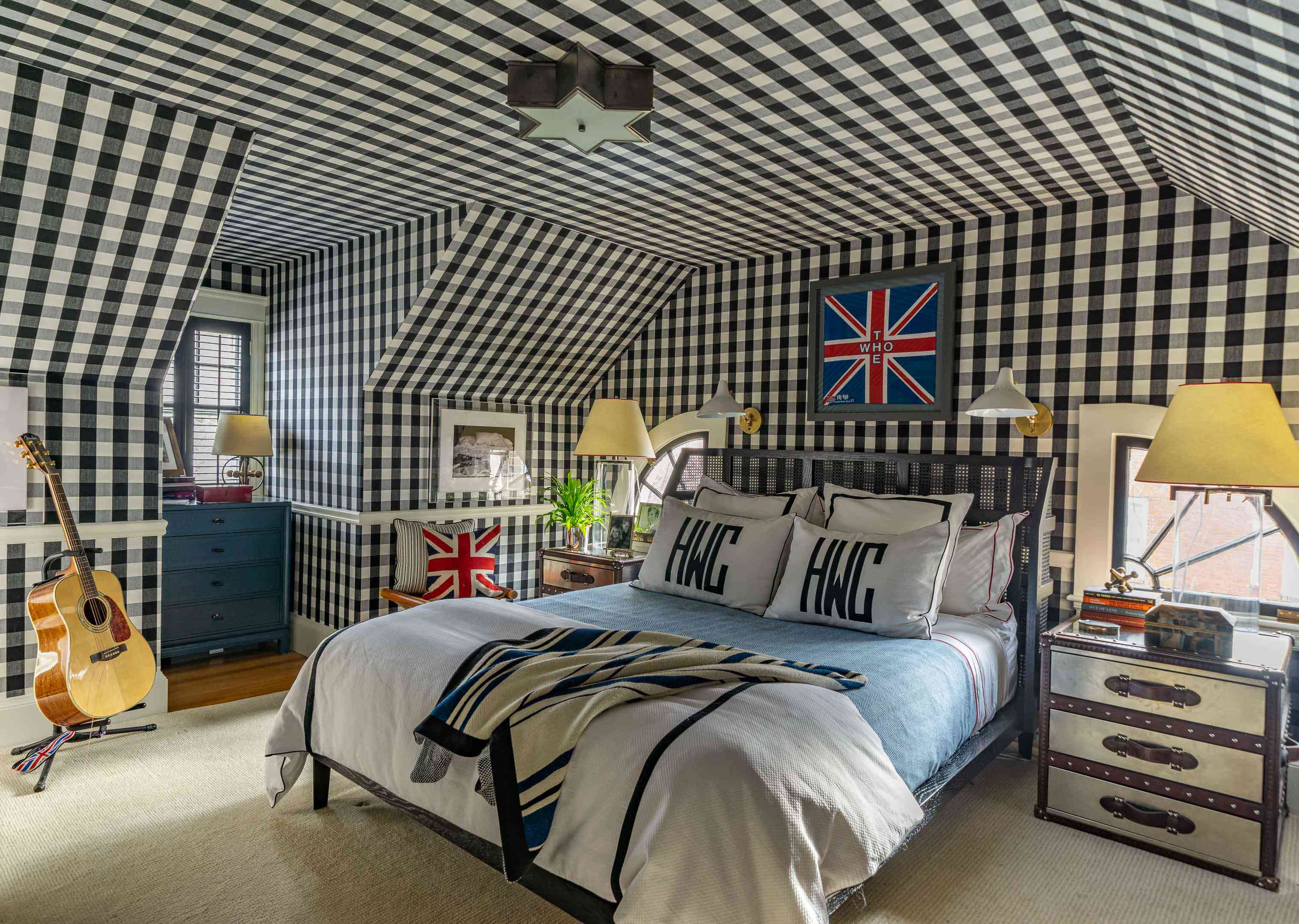 Bedroom with black and white gingham wallpaper.