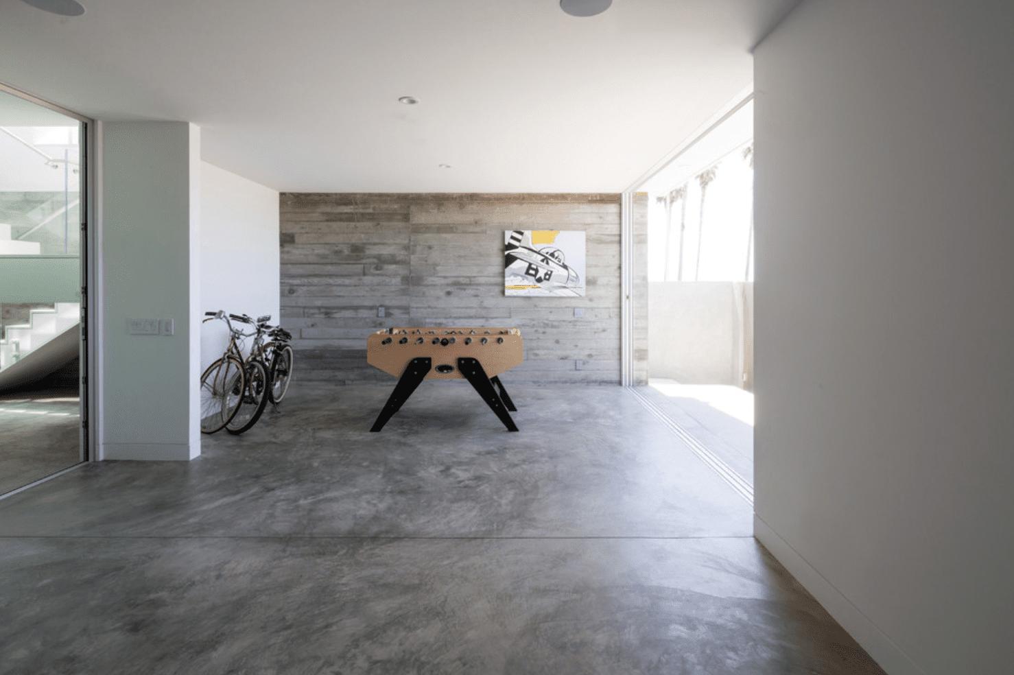 A spacious basement lit with a massive window