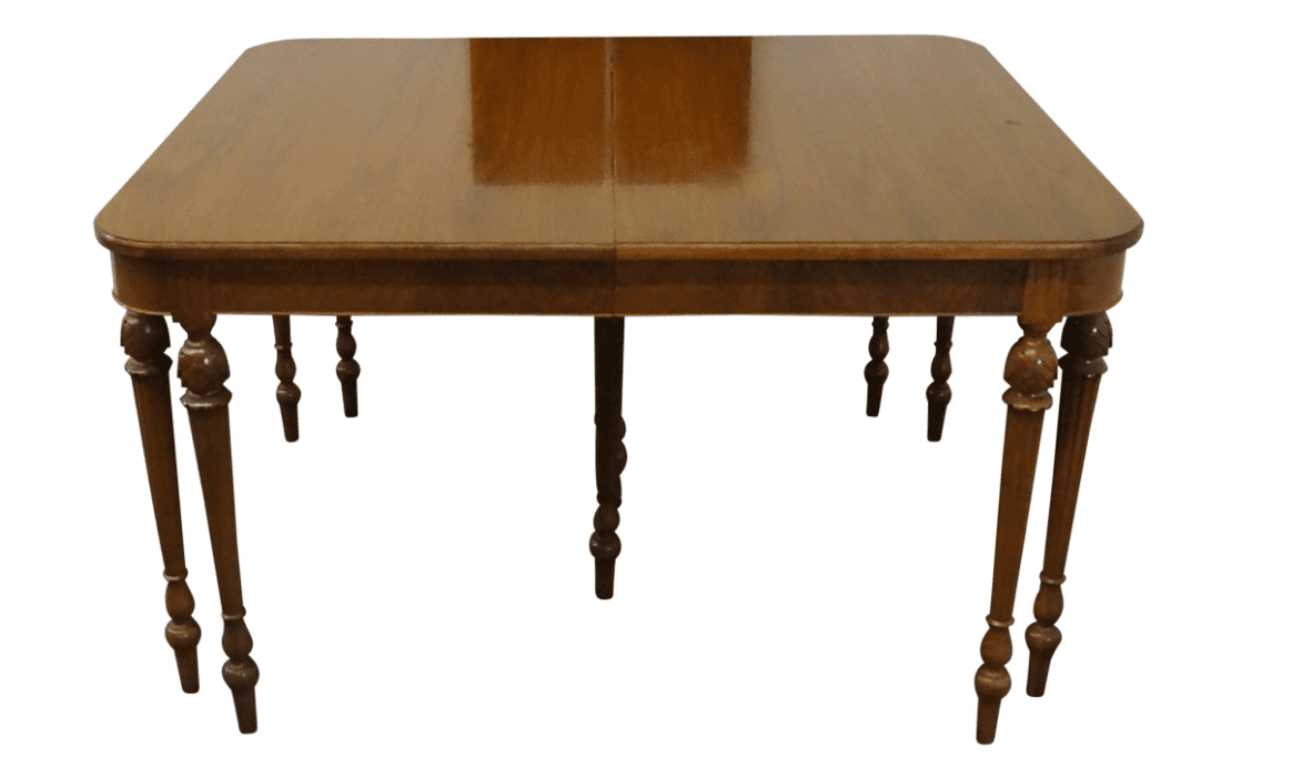 An antique brown dining table.