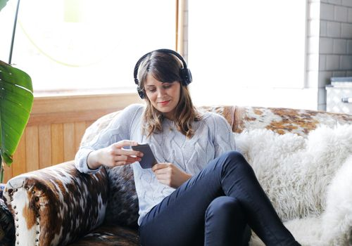 woman listening to podcasts
