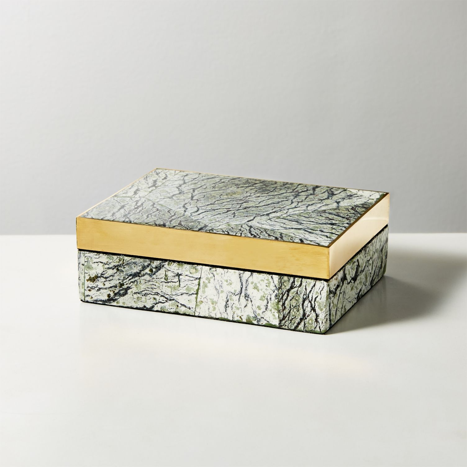 A stone box with gold trim by CB2.