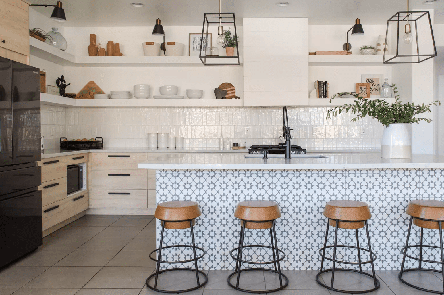 A kitchen with an island that's been covered with printed tiles