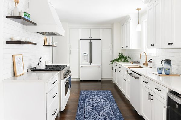Minimalist kitchen with blue patterned runner