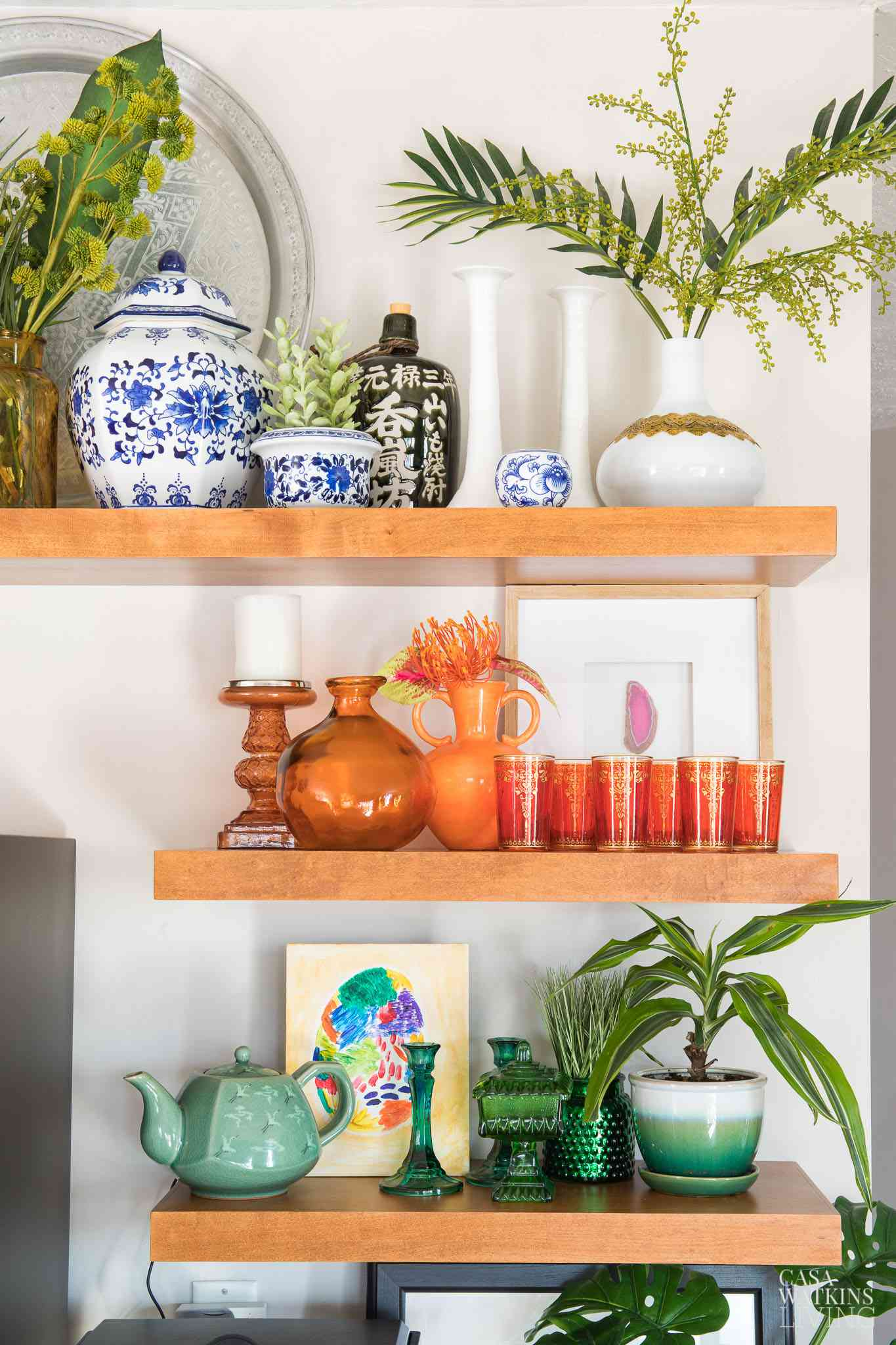 best kitchen ideas - decorative open shelving with colored glass collections