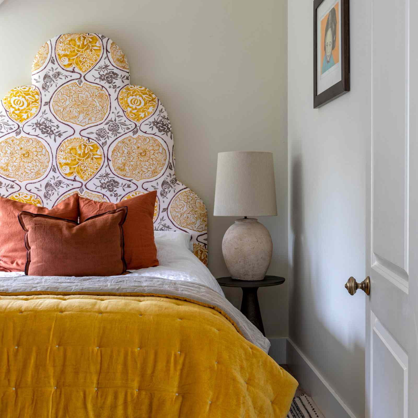 Bedroom with yellow and orange accents
