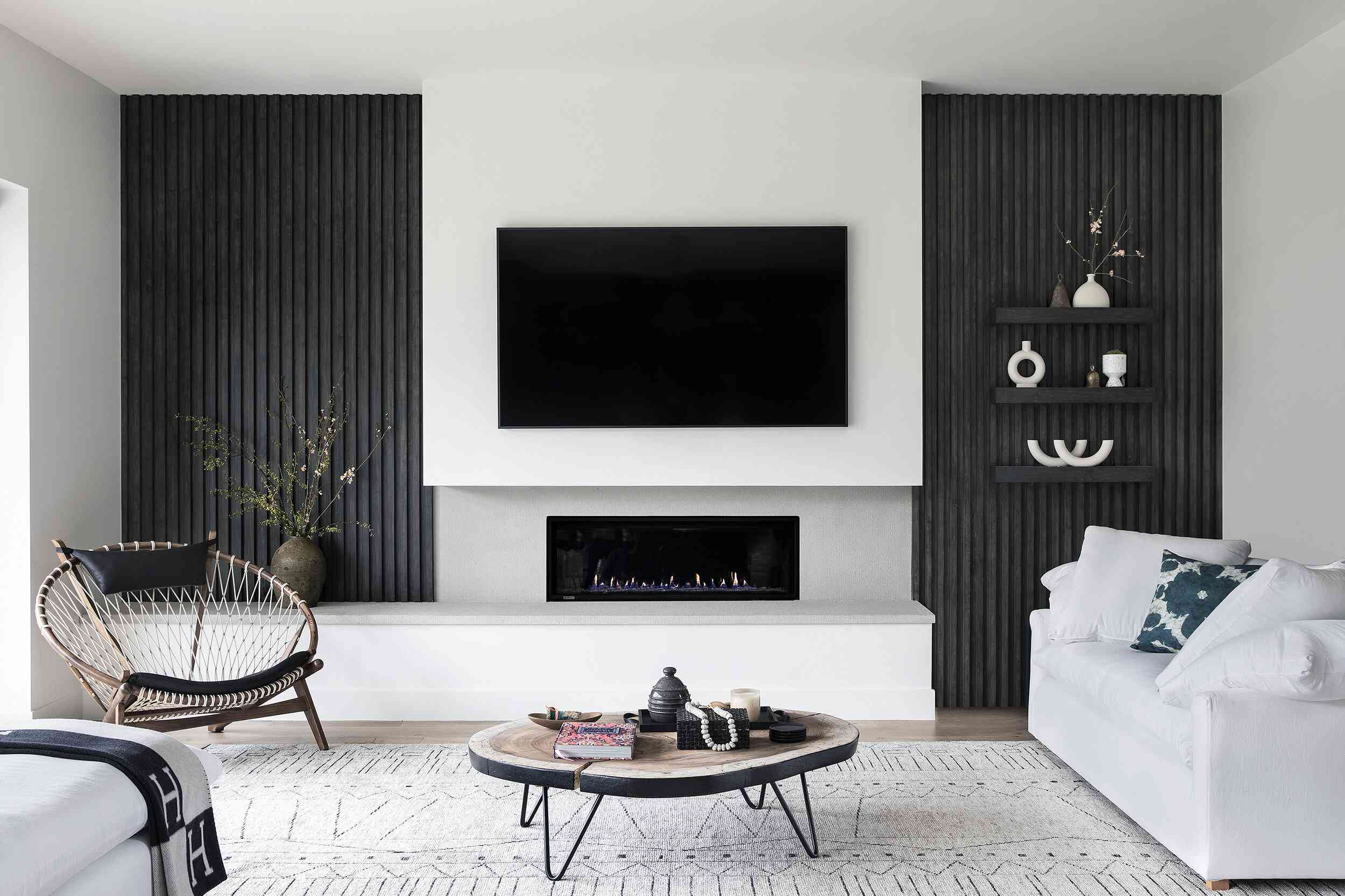 Modern living room with black wood accent wall