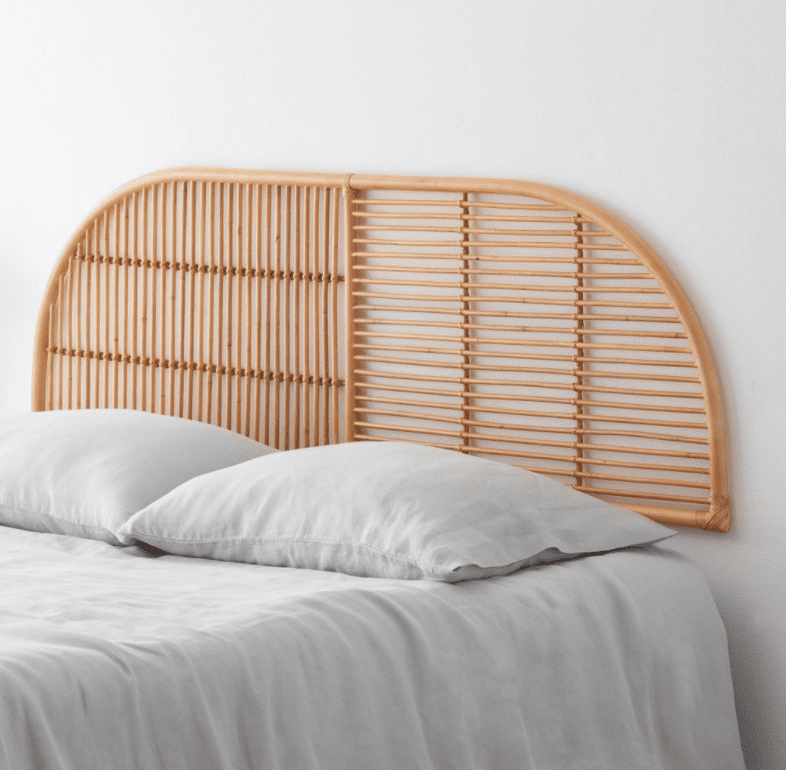A rattan headboard, currently for sale at The Citizenry