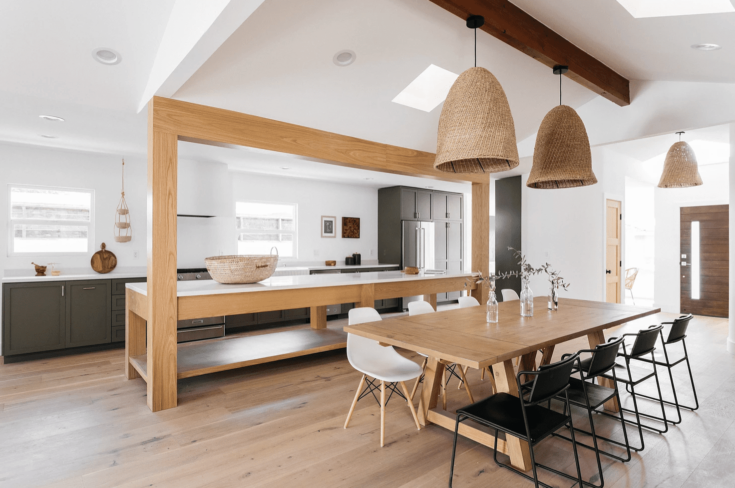 An open-concept kitchen with wood and rattan accents