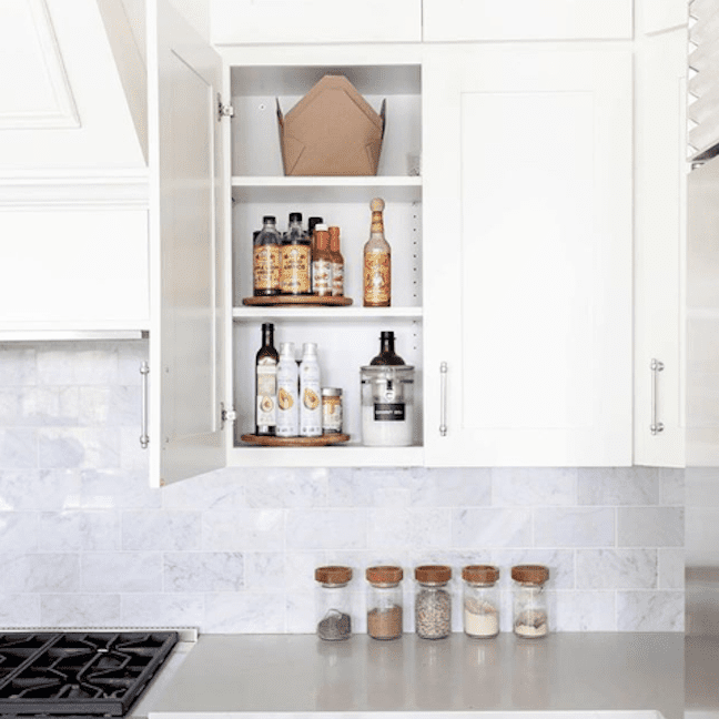 Kitchen cabinet with lazy susan inside.