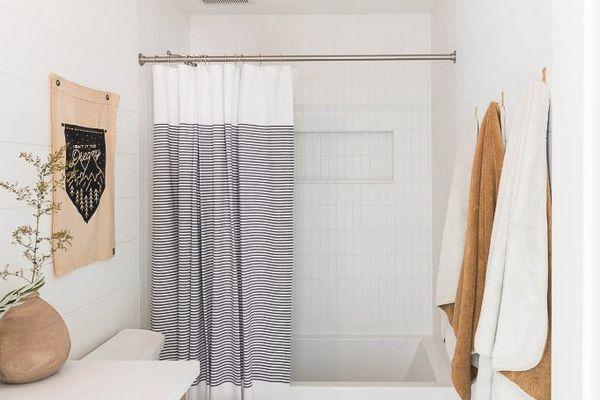 A neat white bathroom with bathtub