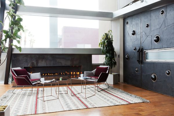 Industrial living room with black walls.