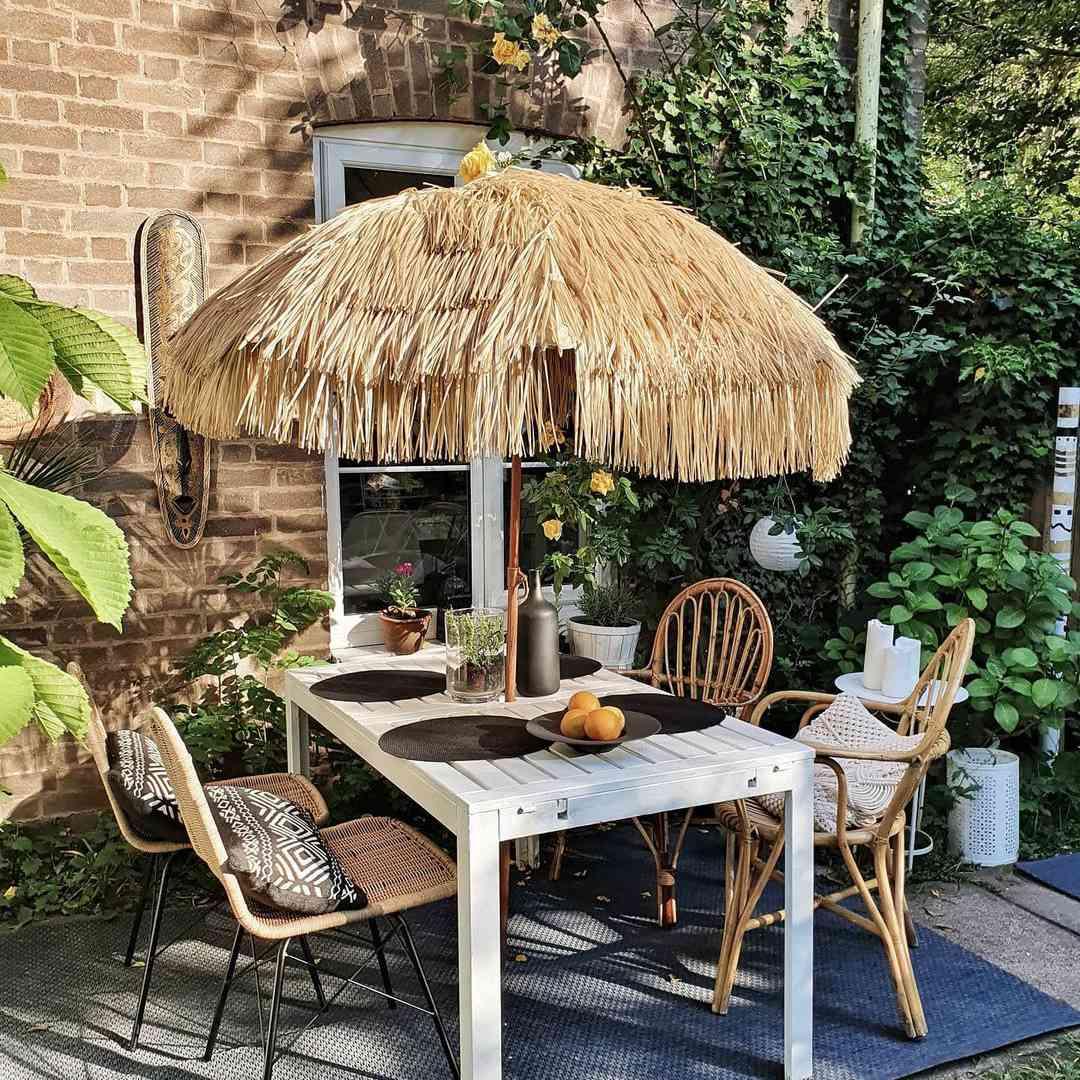 Fun outdoor dining table with tiki umbrella.