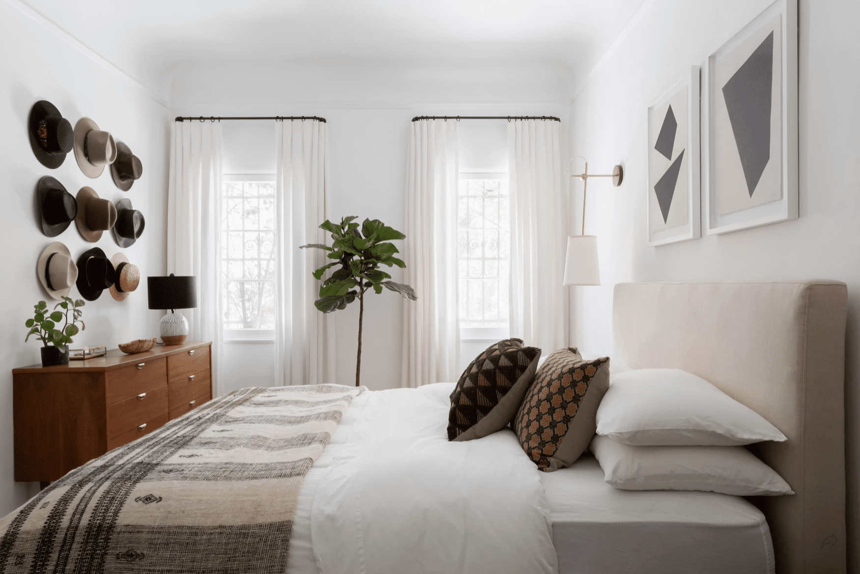 A bedroom with sheer white curtains